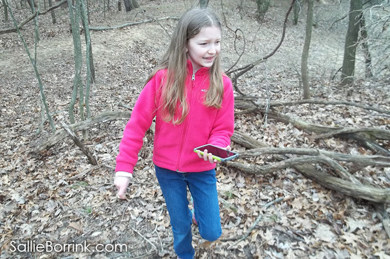 geocaching hunting in woods