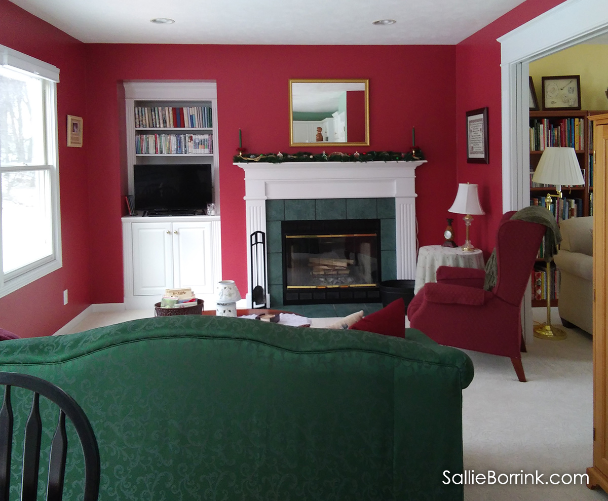 Family Room with fireplace and red walls