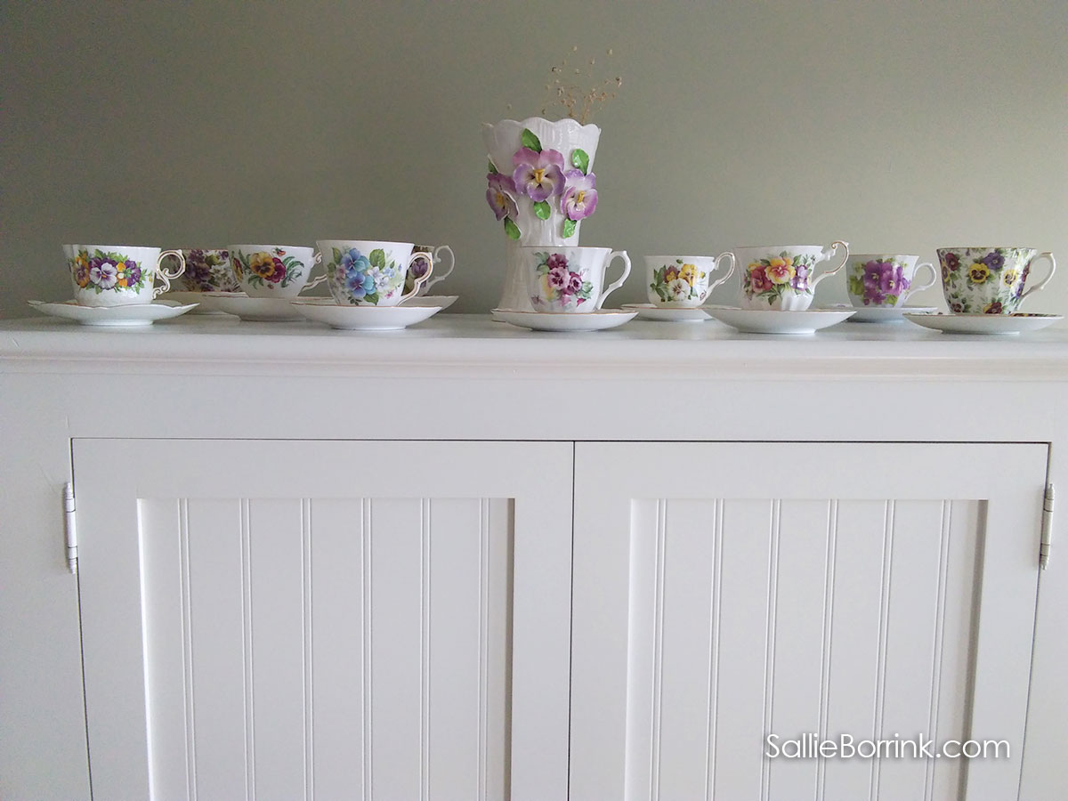 Pansy teacups and saucers in our cozy home