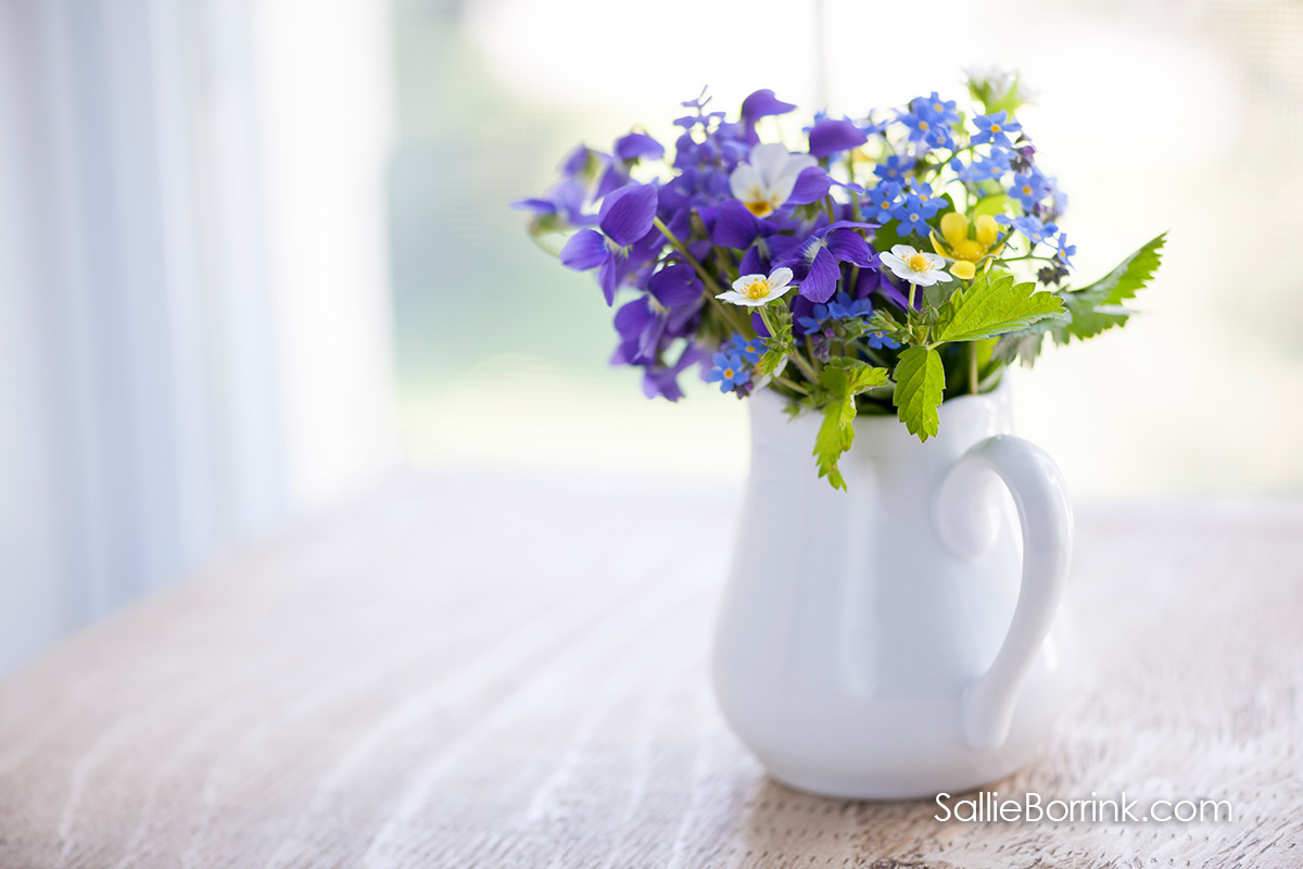 100 Ways to Add Joy to Your Life - Purple flowers in white pitcher